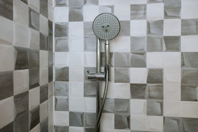 Bathroom, close-up wall new shower head in the elegant stainless steel shower head